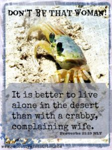 A crab sits on a beach in the sun with Proverbs 21:19 written below.