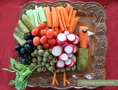 Vegetables arranged on a platter in the shape of a turkey. Perfect for a kids Thanksgiving table!